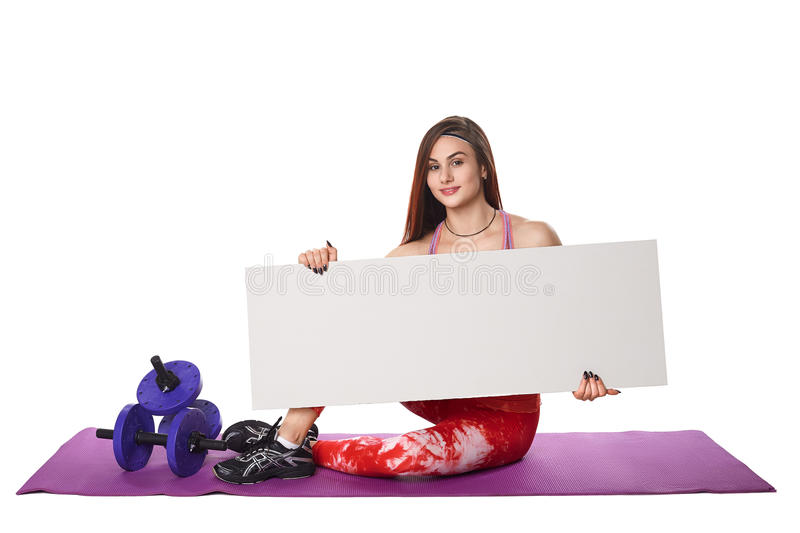 Athletic fitness woman with sign board blank helthy sport isolated white background black clothes yoga poses. Athletic fitness woman helthy sport isolated white stock photo