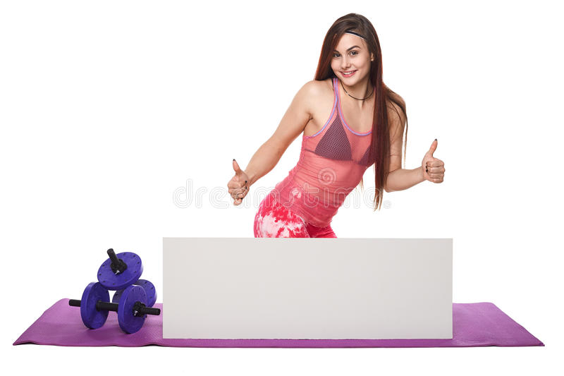 Athletic fitness woman with sign board blank helthy sport isolated white background black clothes yoga poses. Athletic fitness woman helthy sport isolated white stock photography