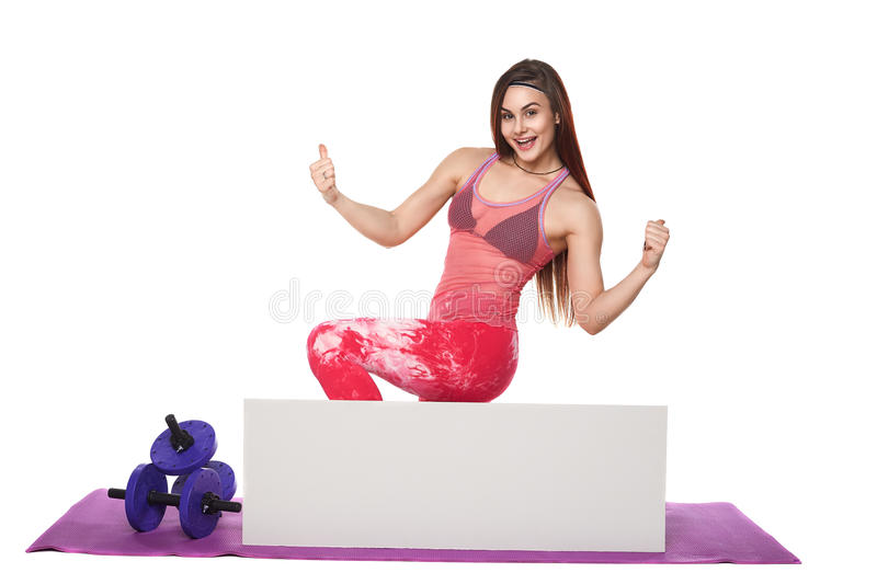 Athletic fitness woman with sign board blank helthy sport isolated white background black clothes yoga poses. Athletic fitness woman helthy sport isolated white stock image
