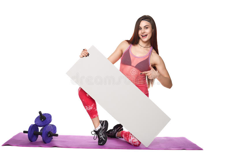 Athletic fitness woman with sign board blank helthy sport isolated white background black clothes yoga poses. Athletic fitness woman helthy sport isolated white royalty free stock images