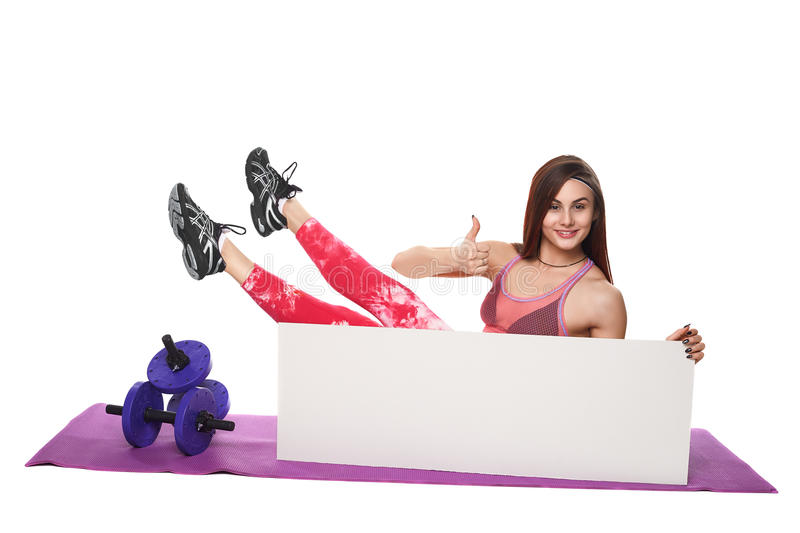 Athletic fitness woman with sign board blank helthy sport isolated white background black clothes yoga poses. Athletic fitness woman helthy sport isolated white royalty free stock photo
