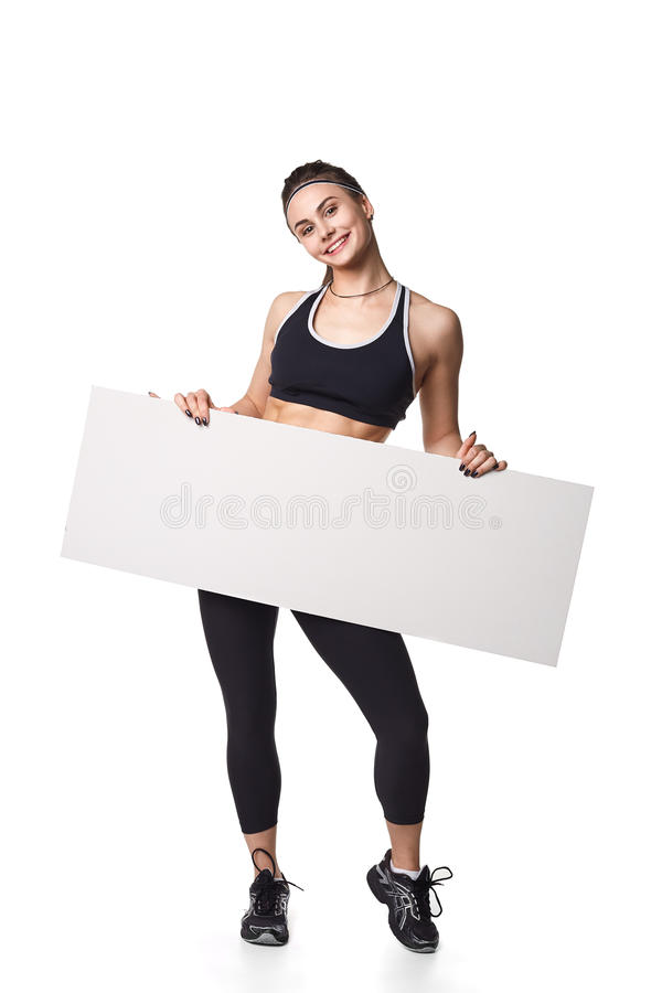 Athletic fitness woman with sign board blank helthy sport isolated white background black clothes. Athletic fitness woman helthy sport isolated white background stock photography