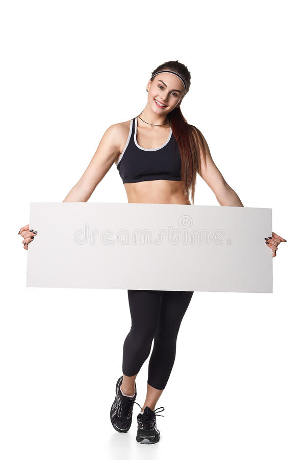 Athletic fitness woman with sign board blank helthy sport isolated white background black clothes. Athletic fitness woman helthy sport isolated white background royalty free stock image