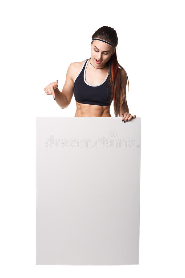 Athletic fitness woman with sign board blank helthy sport isolated white background black clothes. Athletic fitness woman helthy sport isolated white background royalty free stock photography
