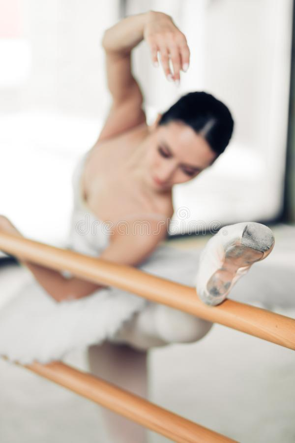 Athletic and flexible woman attending ballet classes royalty free stock image
