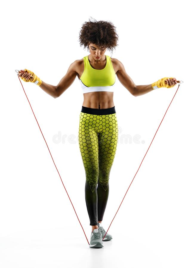 Athletic girl with a jump rope. On white background. Best cardio workout royalty free stock photos