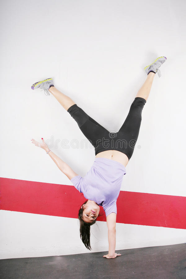 Download Athletic Girl Standing On One Hand Stock Photo - Image: 26920842