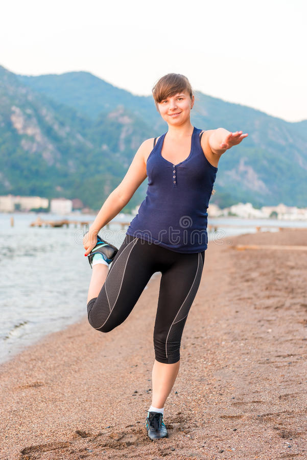 Athletic girl warming royalty free stock photography