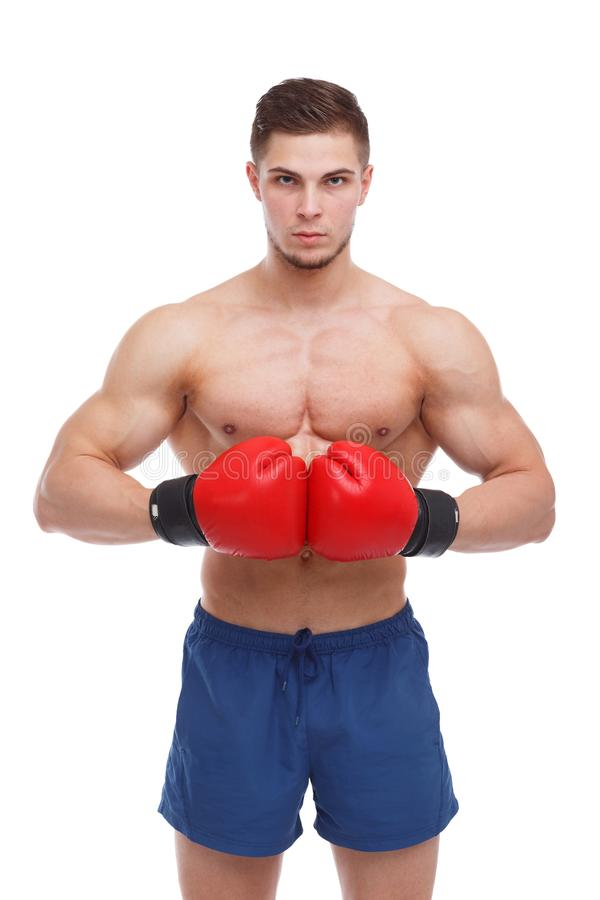 Athletic guy boxer with a bare torso and boxing gloves is connected by a brush at the abdominal level. royalty free stock images