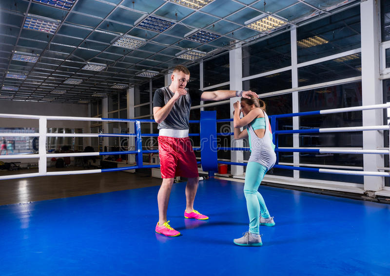 Athletic male and female in sportswear in action practicing boxing royalty free stock image