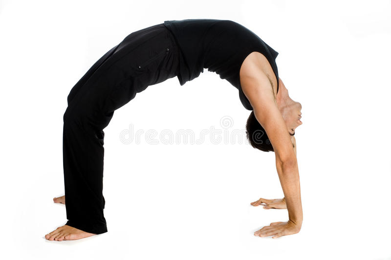 Athletic Man. An athletic man contorting and bending over backwards against white background stock photography