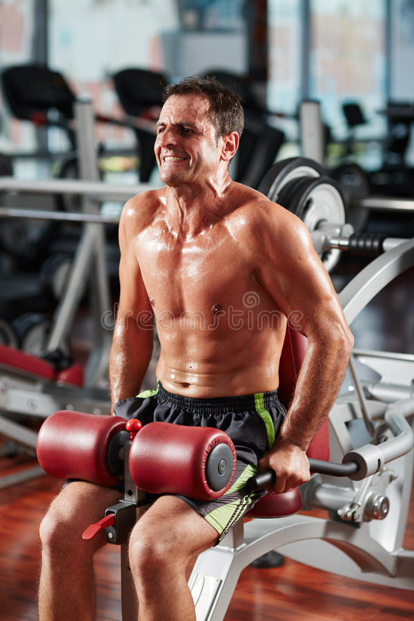 Athletic man doing triceps workout royalty free stock photos