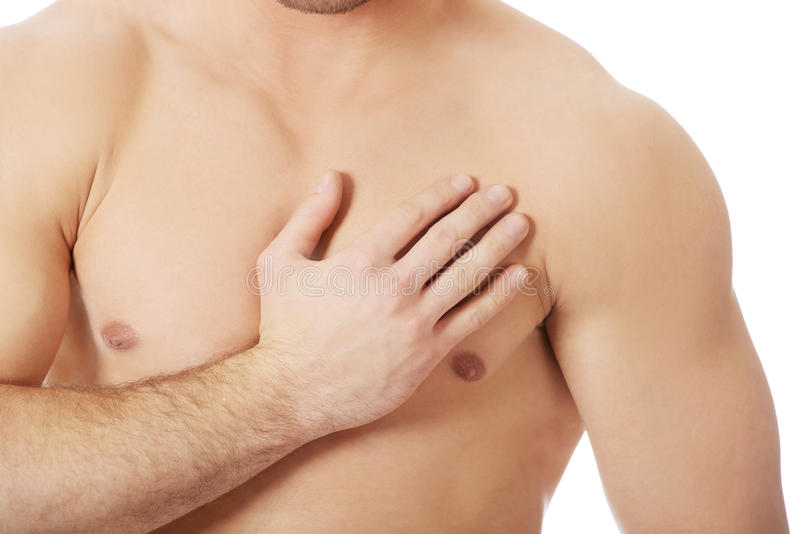 Athletic man feeling pain in his chest. stock photography