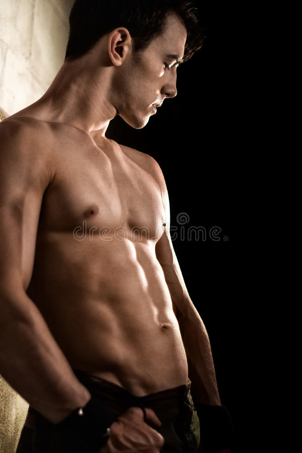Athletic Man Flexing stock photography
