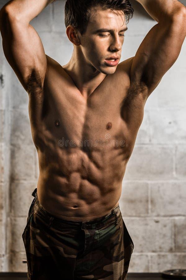 Athletic Man Flexing royalty free stock photo