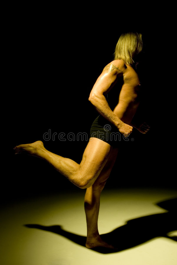 Download Athletic man on one leg stock photo. Image of isolated - 520970