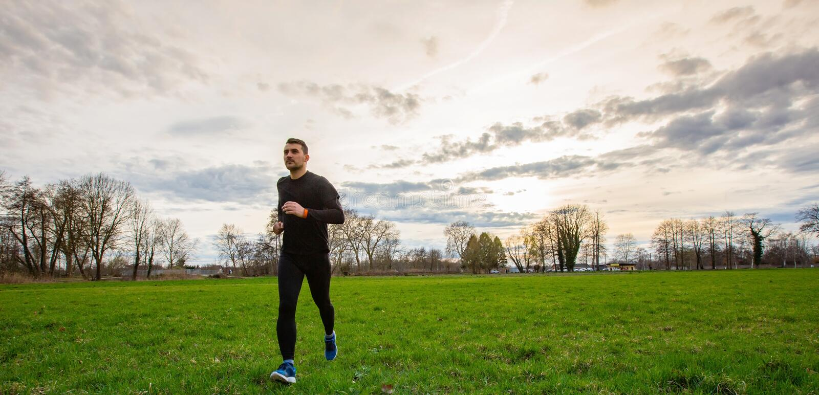 Athletic man practicing sport. Young athletic man practicing sport outdoors city park. Self overcome conquering obstacles and win. Healthy lifestyle concept stock image