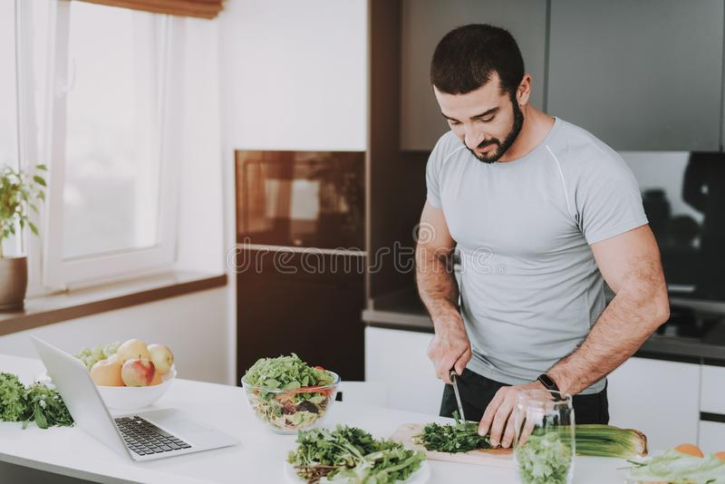 An Athletic Man Is Preparing Salad For Breakfast stock photography