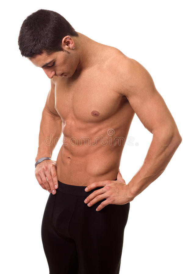 Athletic Man Shirtless. Athletic man, shirtless. Studio shot over white stock photo