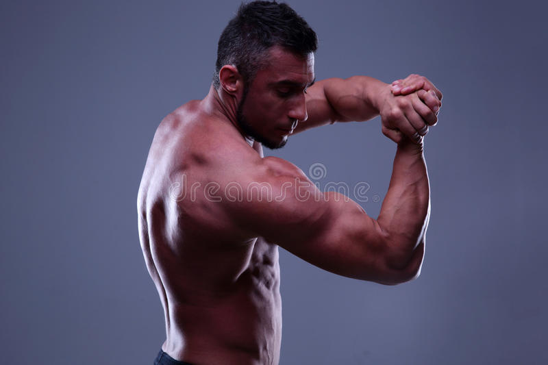 Athletic man showing his muscles stock photos