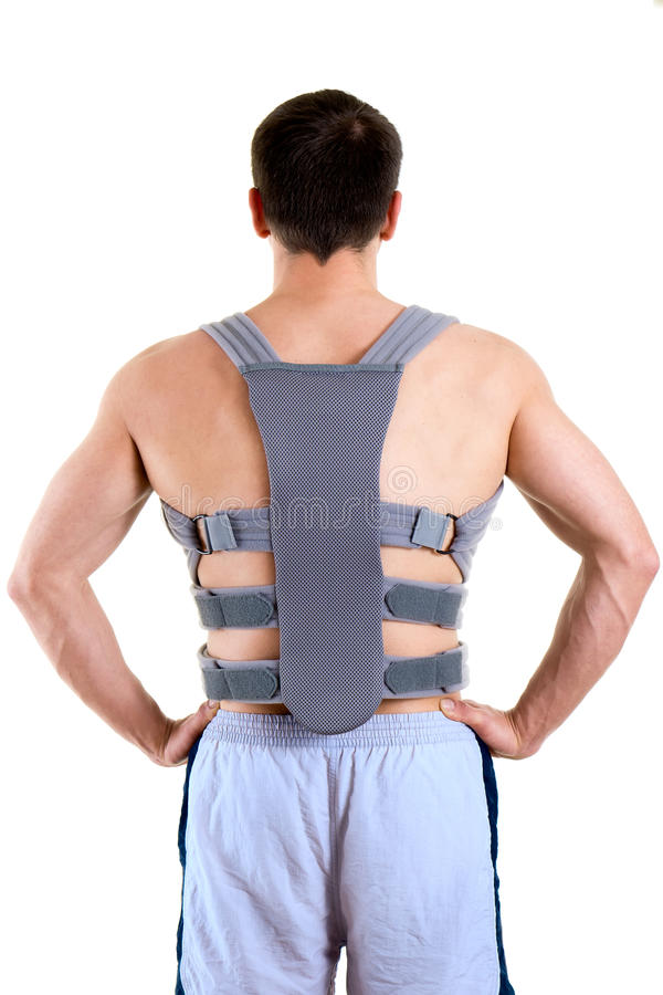 Athletic Man Wearing Supportive Back Brace stock photos