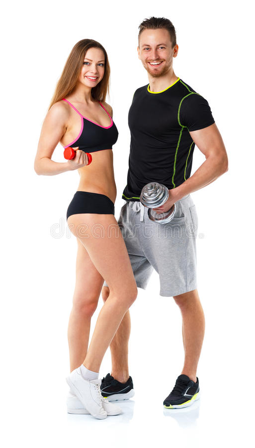 Athletic man and woman with dumbbells on the white stock image