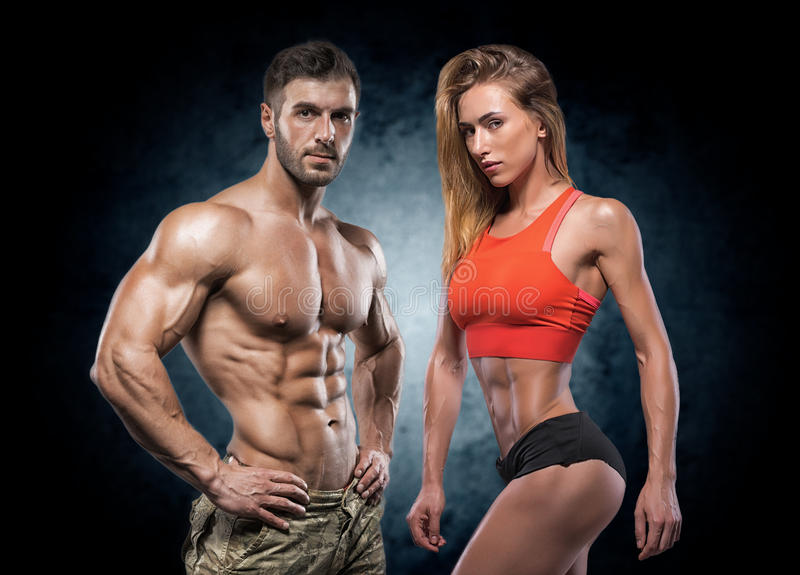 Athletic man and woman. Fitness couple. royalty free stock image
