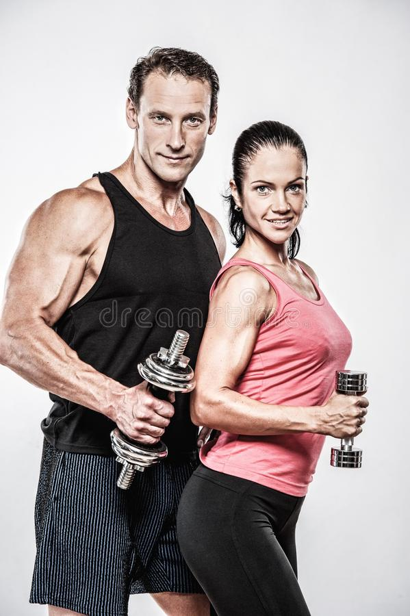 Athletic man and woman stock images