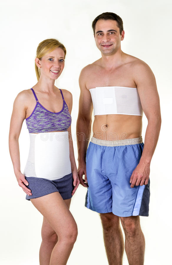 Athletic Man and Woman Wearing Back Support Braces royalty free stock photo