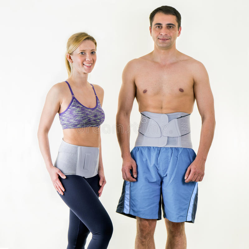 Athletic Man and Woman Wearing Back Support Braces stock photography