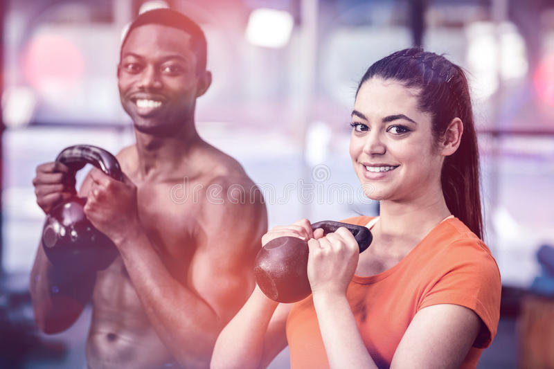 Athletic man and woman working out stock image