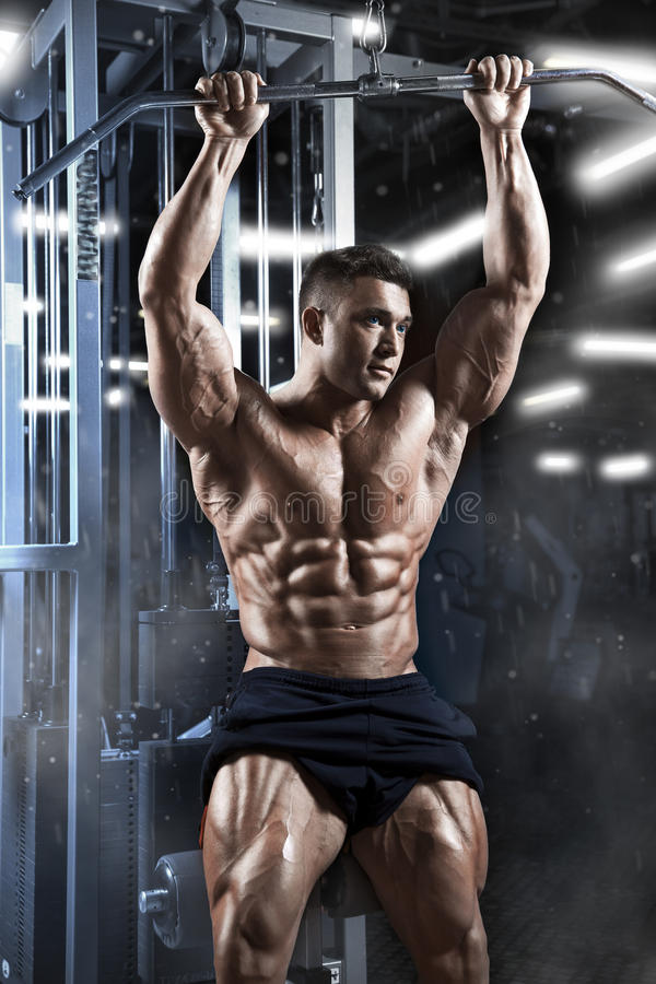 Athletic muscular guy prepare to do exercises with athletic trainer in a gym stock photos