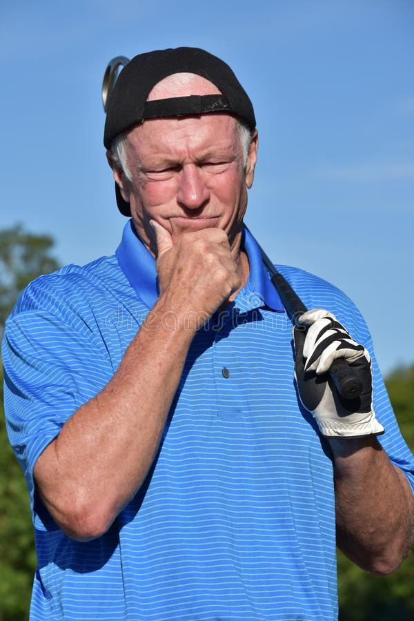 Athletic Retiree Male Golfer Decision Making With Golf Club Playing Golf stock photography