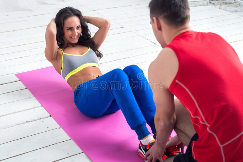 Athletic sporty couple friends. Woman doing stock image