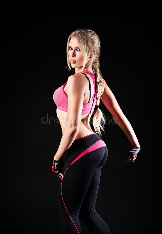 The athletic strong young girl. Half-turned portrait royalty free stock photo
