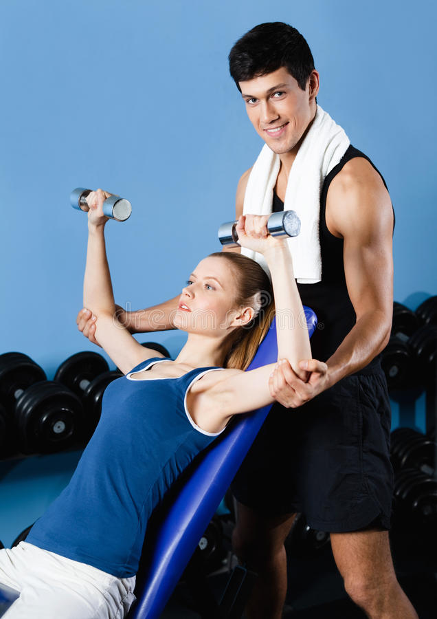 Download Athletic Trainer Helps Woman To Exercise Royalty Free Stock Photography - Image: 26548317