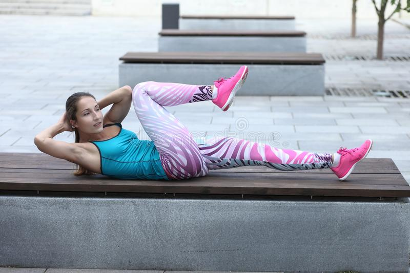 Athletic woman doing exercise on abdominal muscles stock photo