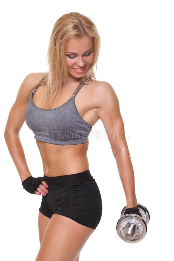 athletic woman doing a fitness workout with dumbbells stock photos