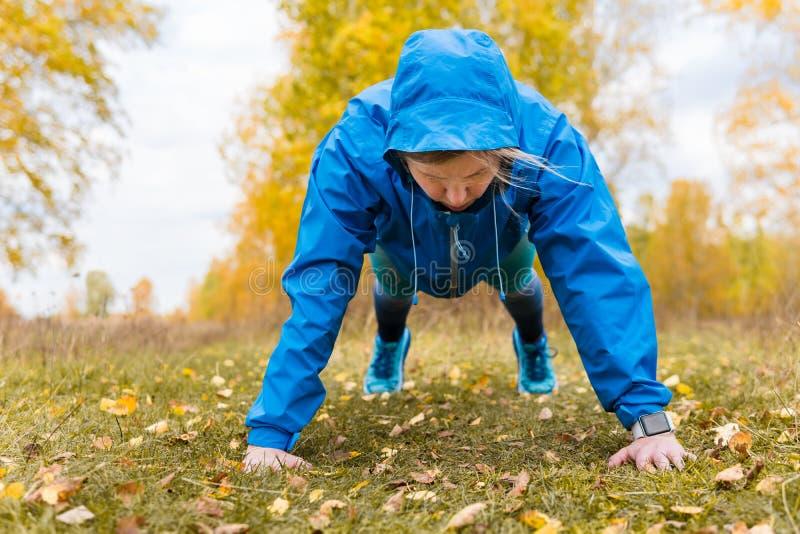 Athletic woman doing push-ups. Hard Workouts. Athletic woman doing push-ups. Hard Workouts royalty free stock photos