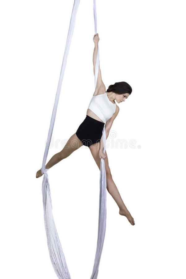 Athletic woman doing some tricks on silks stock image