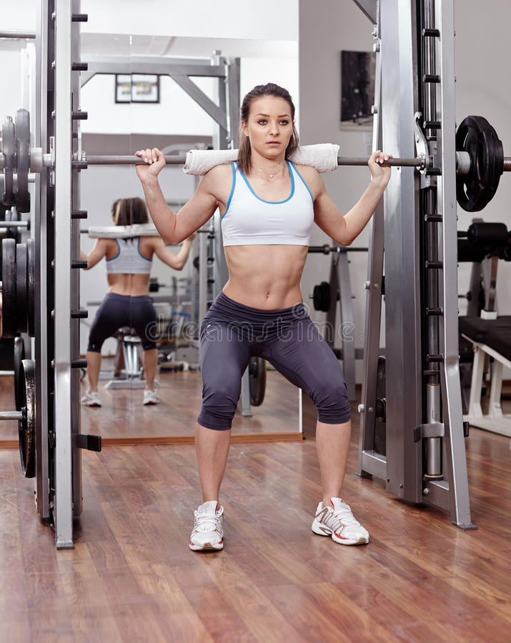 Download Athletic Woman Doing Squats At The Gym Stock Image - Image: 39893367