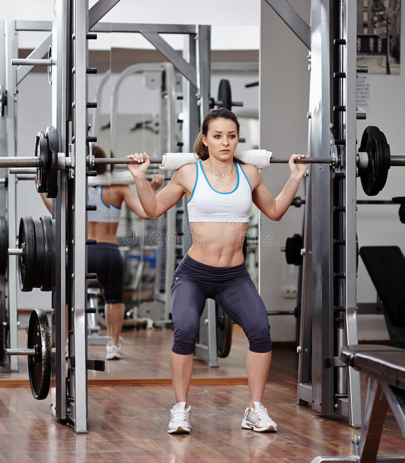 Download Athletic Woman Doing Squats At The Gym Stock Photo - Image: 39893369