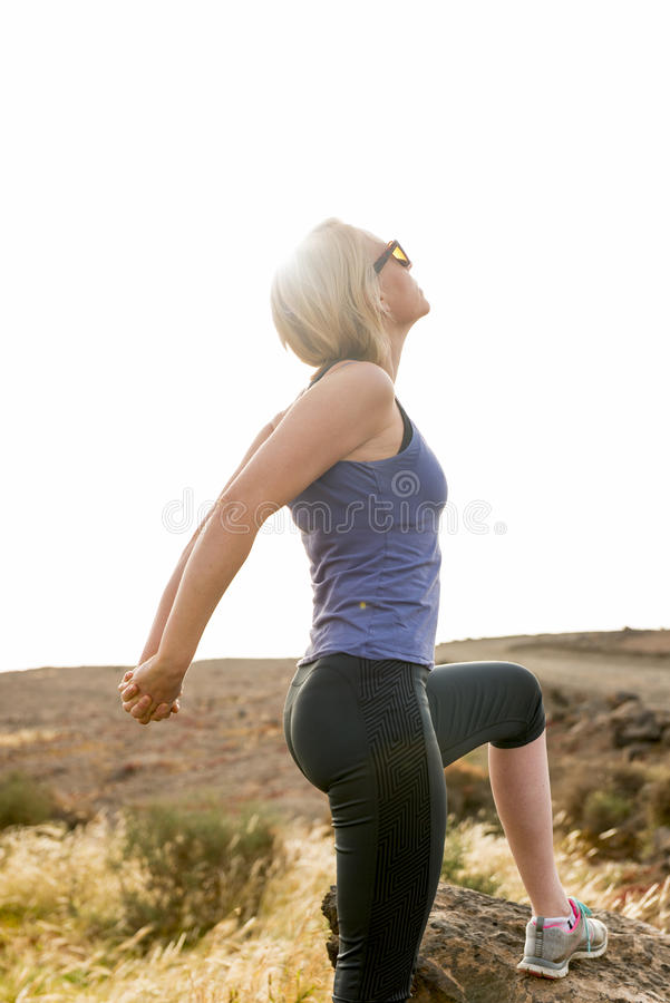 Athletic Woman Doing Stretches Outdoors stock photos