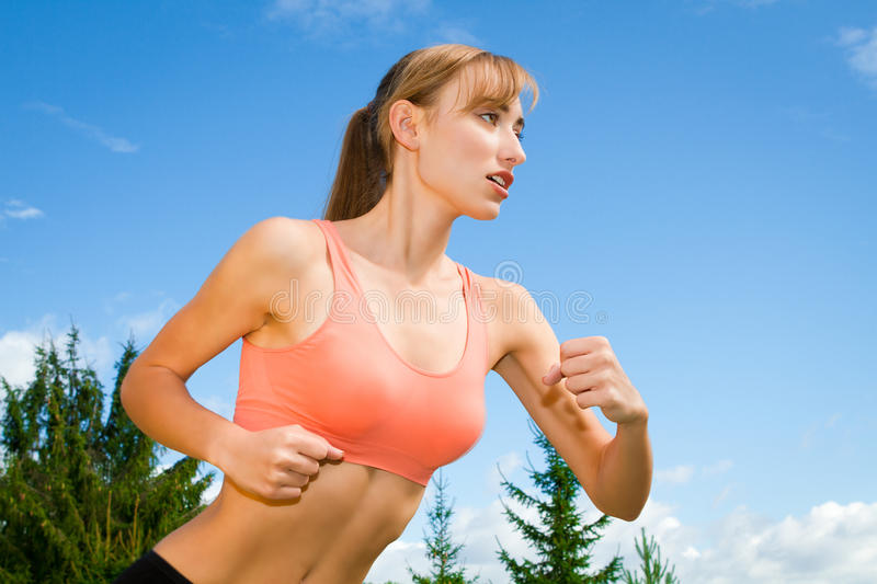 Athletic Woman Exercising stock photography
