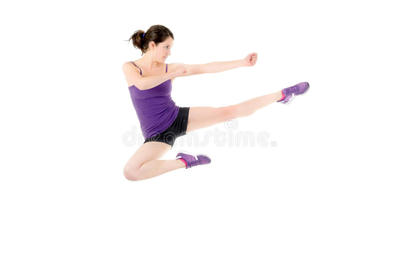 Download Athletic Woman Performing A Flying Side Kick Stock Image - Image: 29862199