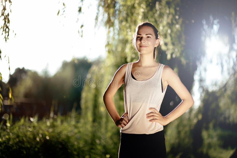 Athletic woman ready to run. Athletic woman ready to jog royalty free stock photos