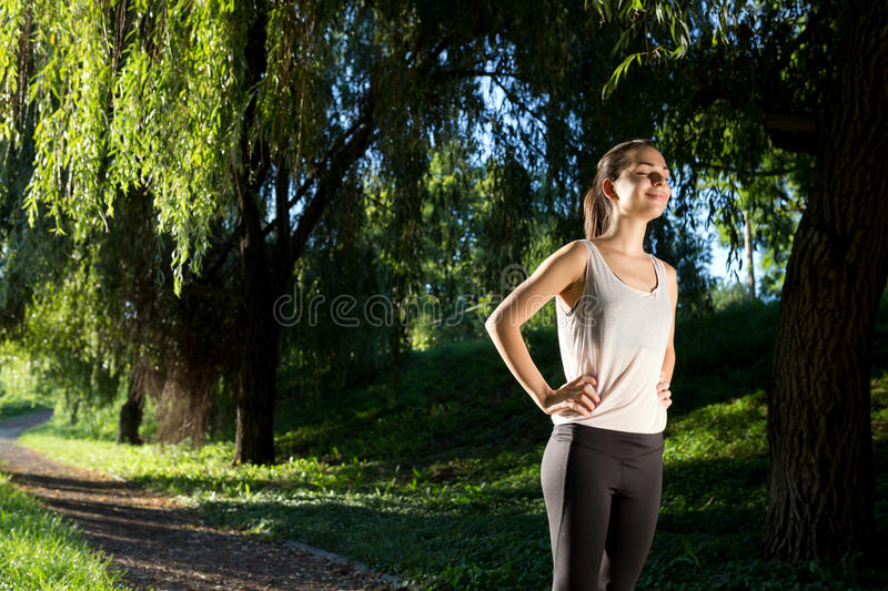 Athletic woman ready to run. Athletic woman ready to jog royalty free stock photography