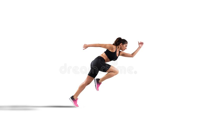 Athletic woman runner isolated on white background. Athletic woman runner in sportswear on the asphalt of a road isolated on white background stock photo