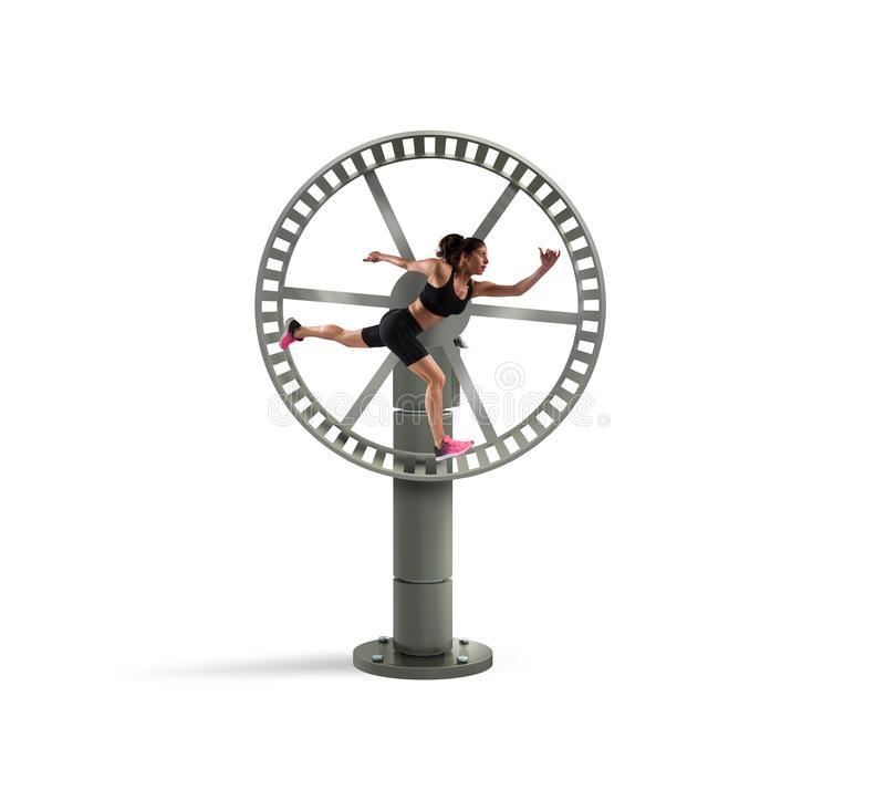 Athletic woman runs in a looping wheel. concept of sport routine royalty free stock photos