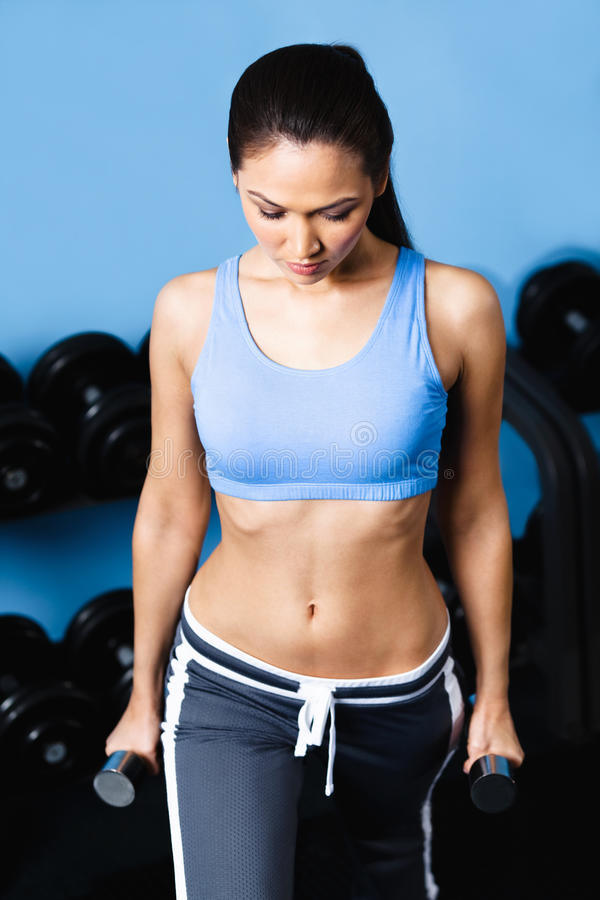 Download Athletic Woman Works Out With Dumbbells Stock Image - Image: 26548351